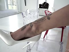 Hot chick isn't inveigh against time with chit chat so she gives a footjob right away