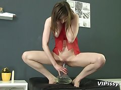 Lingerie girl pours piss on herself and sucks a dick