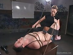 Cruel domina Audrey Leigh strapon fuck anal hole of man almost tied up balls