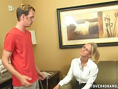 Blonde of age Simone Sonay with glasses milks a young learn of on her