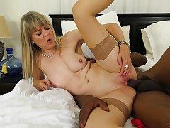 Hot mature smashes huge blacklist dick in both her pink holes