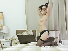 Handsome brunette Di Devi plays with the brush small tits and wet cunt