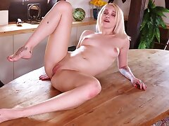 Sweet solo princess Marilyn Sugar fingers her pussy on the bed