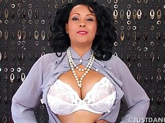Busty cougar Danica Collins in stockings and mighty heels having fun