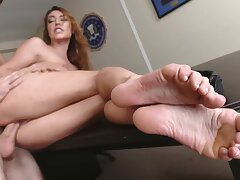 Playful brunette teases with her soft feet while being rammed